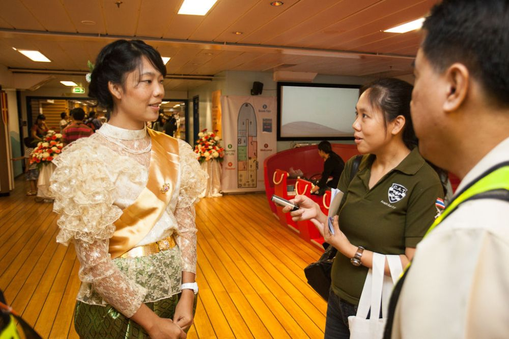 Ships: Bangkok, Thailand :: Lynchee Buakham (Thailand) is interviewed by a local journalist. More Info