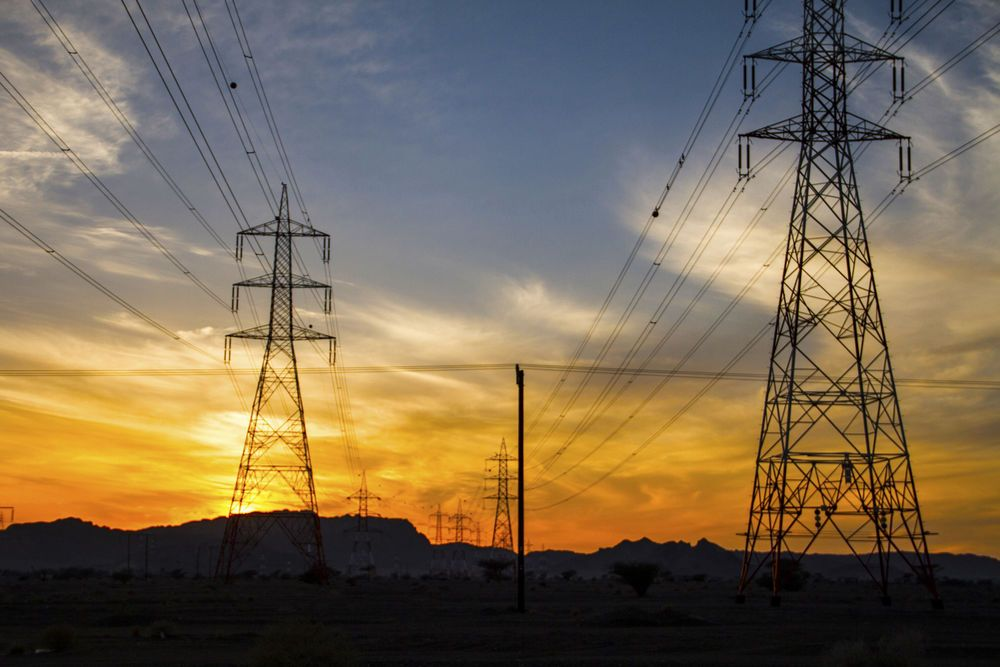 Power towers commonly seen across the deserts of the Arabian Peninsula.     Photo by Kathryn Berry