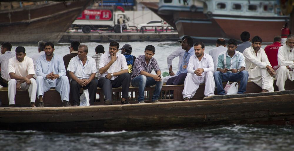 Arabian Peninsula: Workers from several nations travel across the waterway in Dubai.  