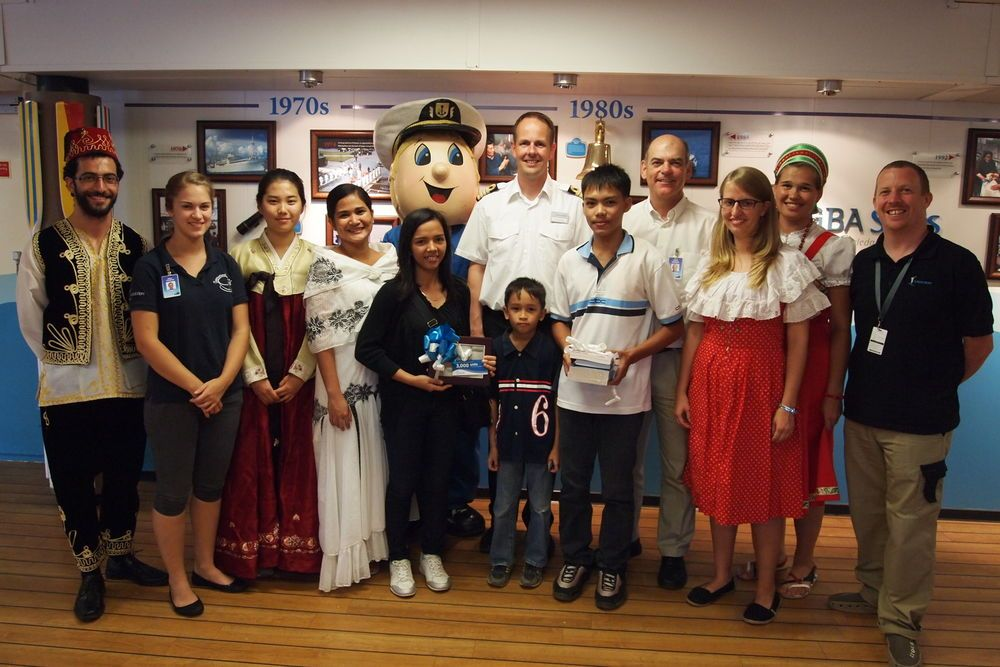 Philippines: Logos Hopes three millionth visitor Ms Cyrille Fernando (front, at centre) with family members, Captain Dirk Colenbrander (Netherlands), Director Lloyd Nicholas (Australia) and other crewmembers. More Info
