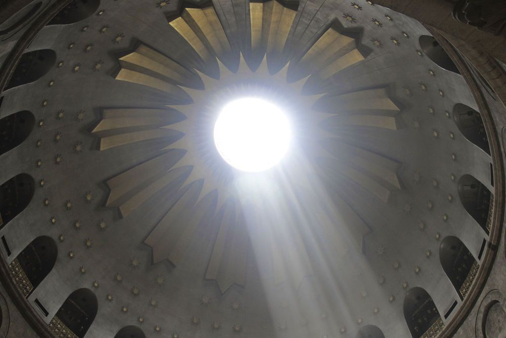 Israel: Light streams through the ceiling in the Holy Sepulcher and reminds this visitor that the Lord hears our prayers. 