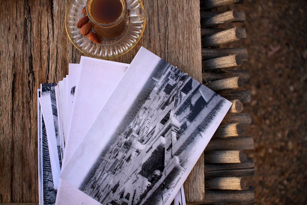 North Africa: Almond tea and old photos of the city, spark conversation in North Africa.   Photo by Kathryn Berry More Info