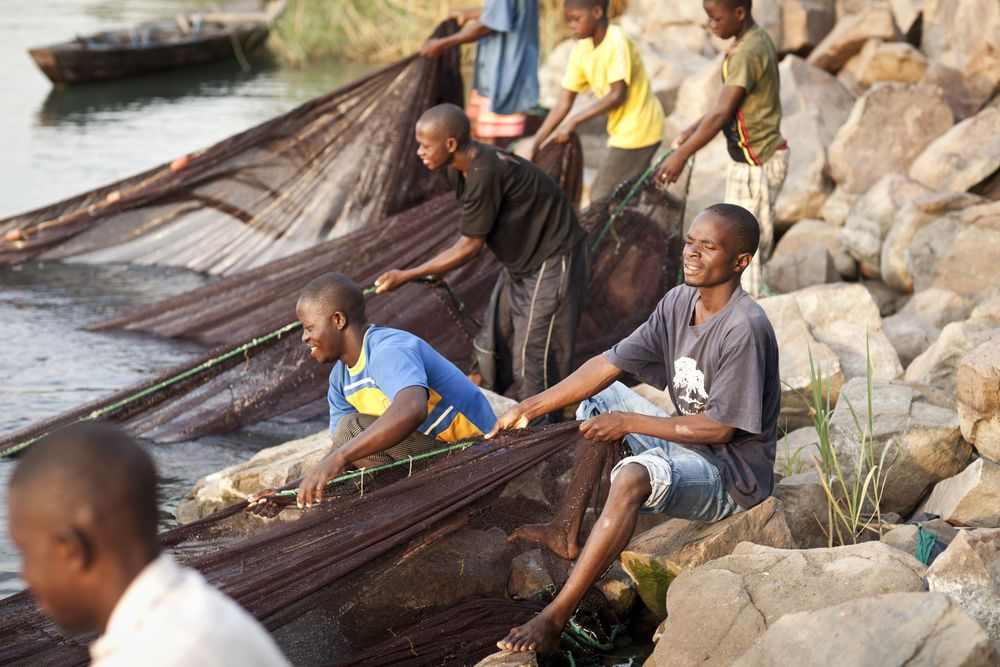 International: Fisherman working with their nets in Lake Tanganyika. More Info
