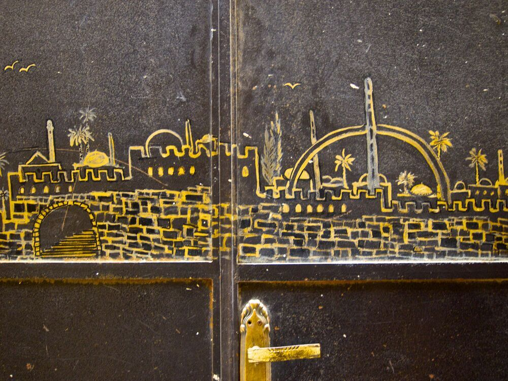 Israel: A door with an engraved image of Israel.  Photo by Inga Riley More Info