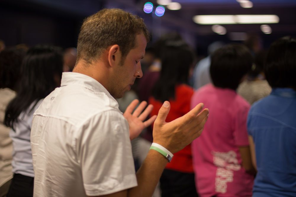 Central Asia: An Albanian participant spends time in prayer during Transform 2014 More Info