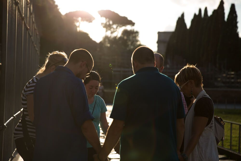 International: One team prays together at the end of the outreach day during Transform 2014 More Info