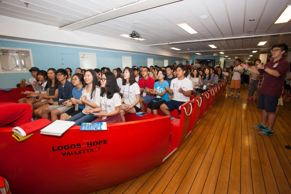 Ships: Incheon, South Korea :: Visitors sit and enjoy a programme presented by ships company in the Life Boat on Deck 4. More Info