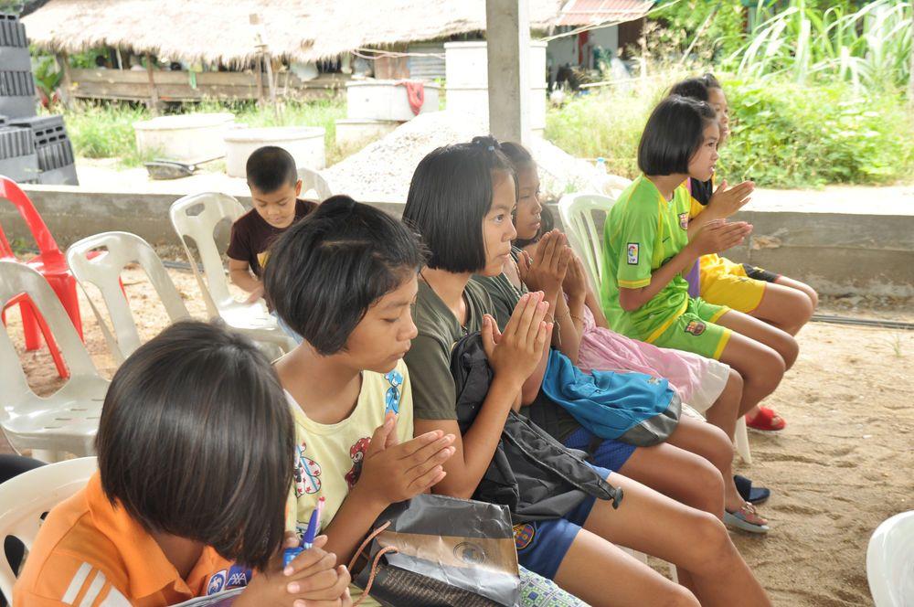 Kamphangphet, Thailand: Local children praying after a time of Bible teaching during English class.