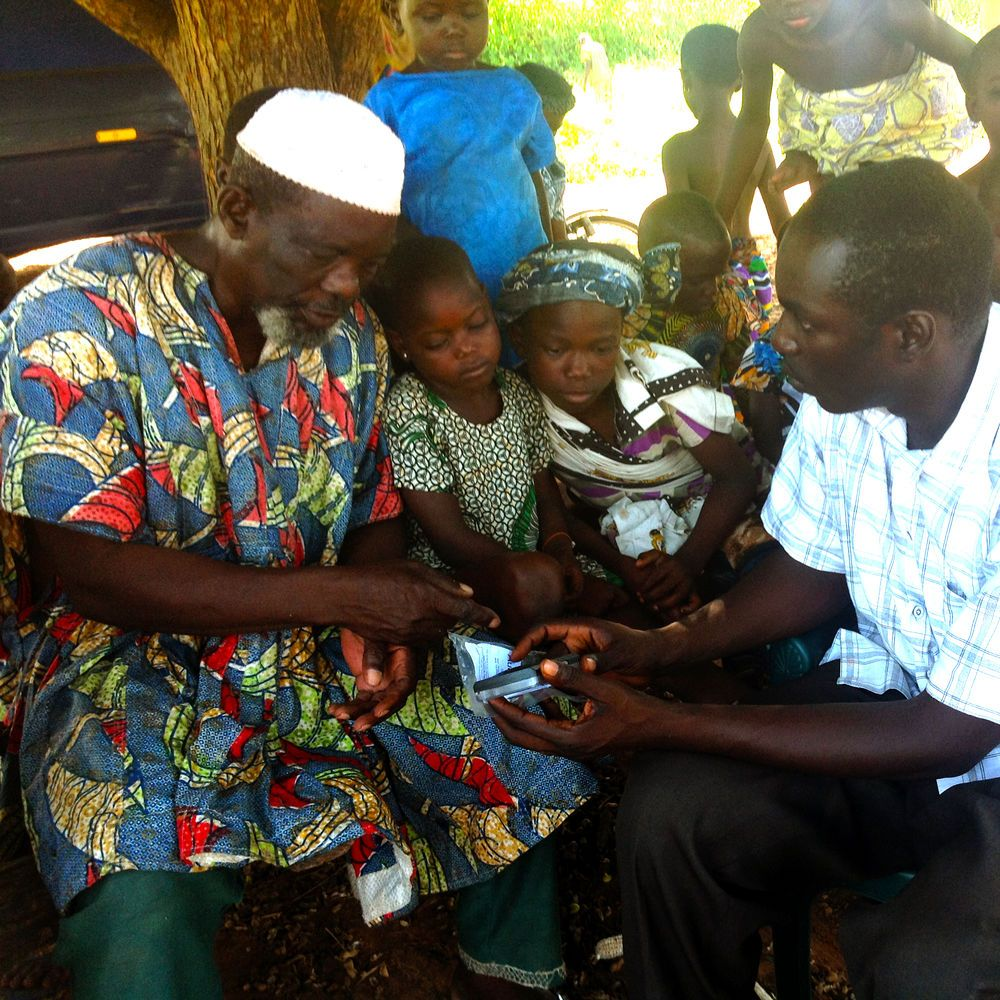 Ghana: Chris explains how to use an AudiBible to a local Muslim village leader. More Info