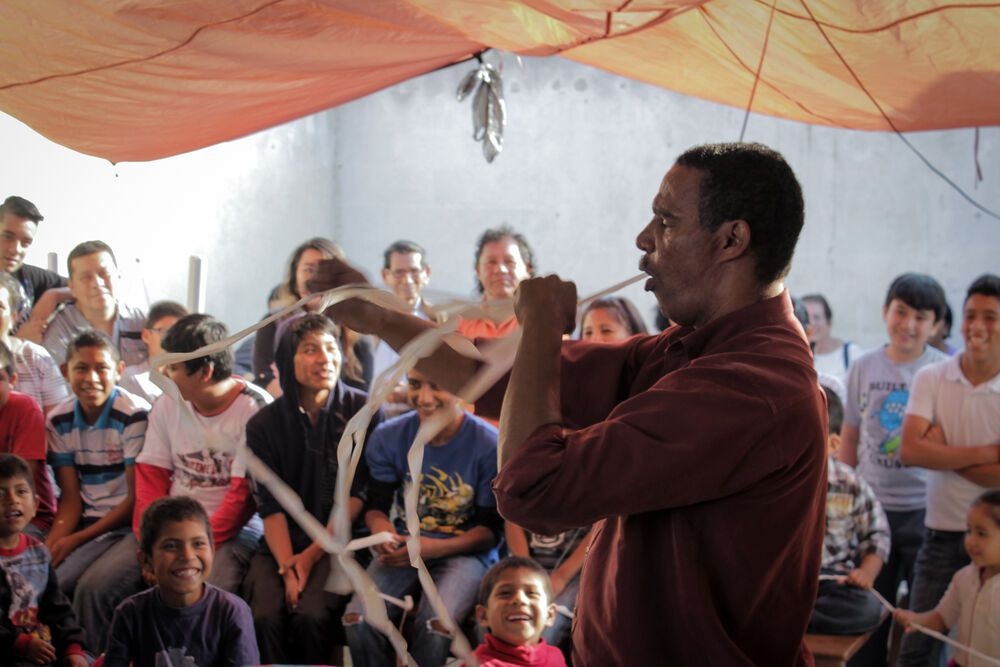 Guatemala: A christian magician makes the children laugh during a Christmas celebration in Guatemala. More Info