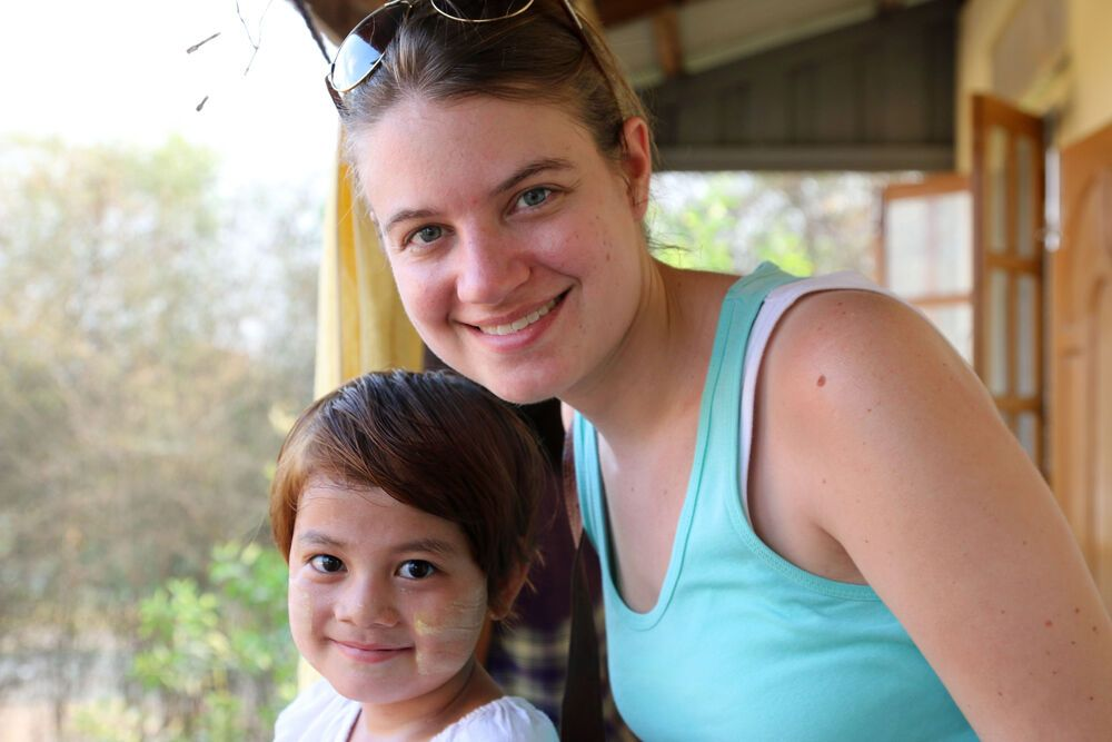 An orphan girl from an OM partner orphanage north of Yangon with OMNIvision producer Katie Morford