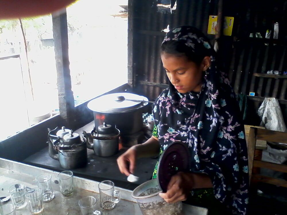 Bangladesh: A young girl works in her fathers tea shop in Bangladesh. More Info