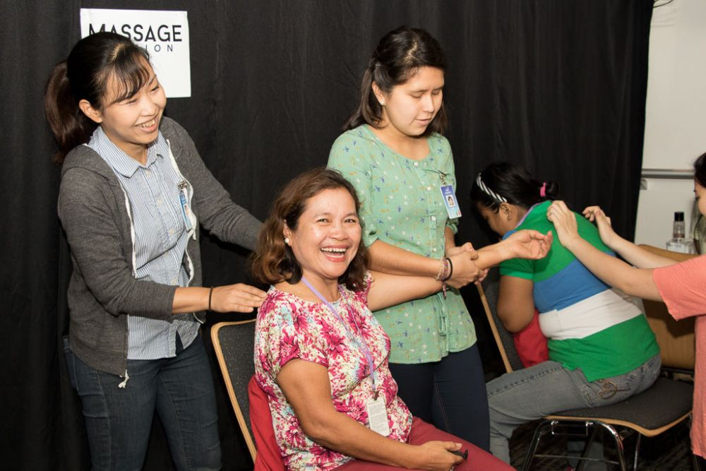 Cebu, Philippines :: Haruka Kamauchi (Japan) and Naibi Aguilera (Mexico) give a woman massage at the onboard event Refreshing Love in the Hope Lounge.
