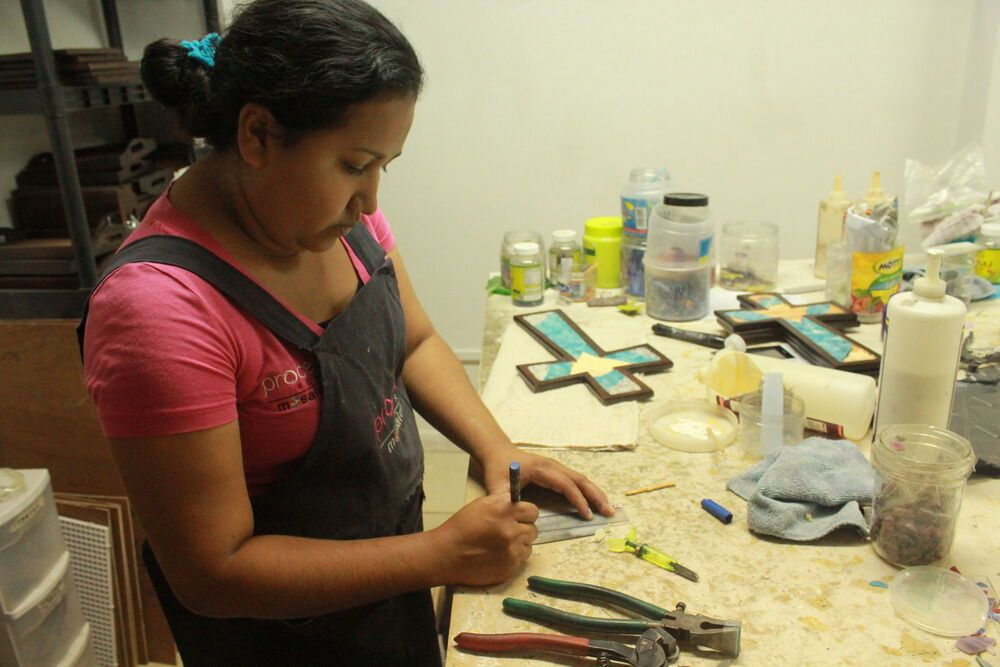 Costa Rica: One of the women of Pearl Process (OM Costa Rica) working on making mosaics.  More Info