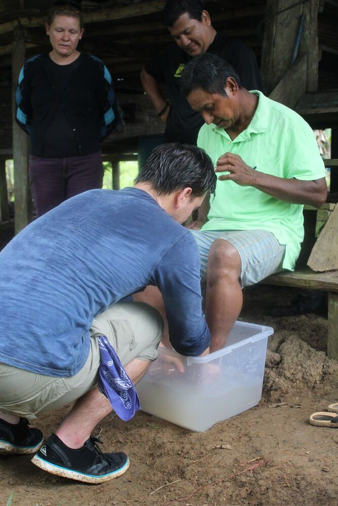 Costa Rica: Jordan washing Enriques feet as he prays over him and his daughters.  More Info