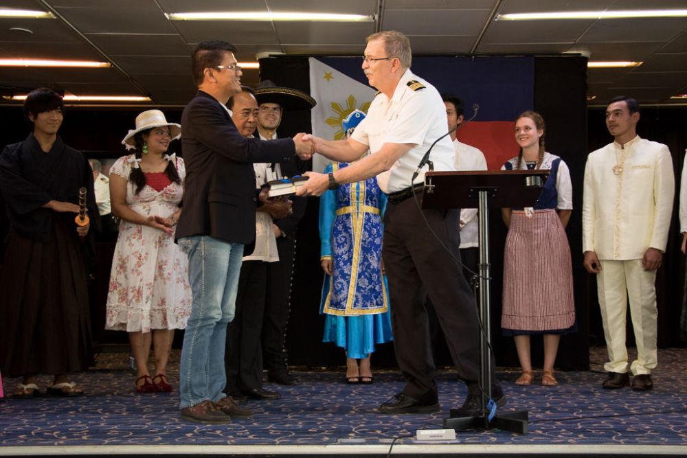 Subic Bay, Philippines :: Vice Governor of Zambales, Ramon Lacbain accepting a gift from Captain Tom Dyer (USA)  at the Official Opening onboard event.