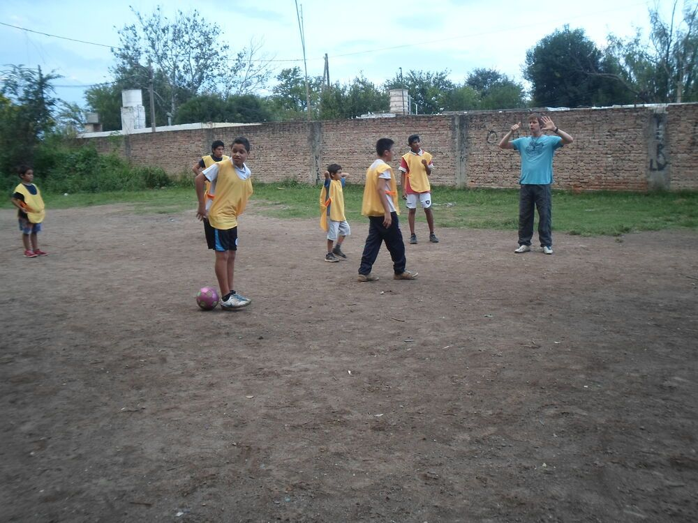 Argentina: Coach and trainees at the new football court in Cordoba, Argentina More Info