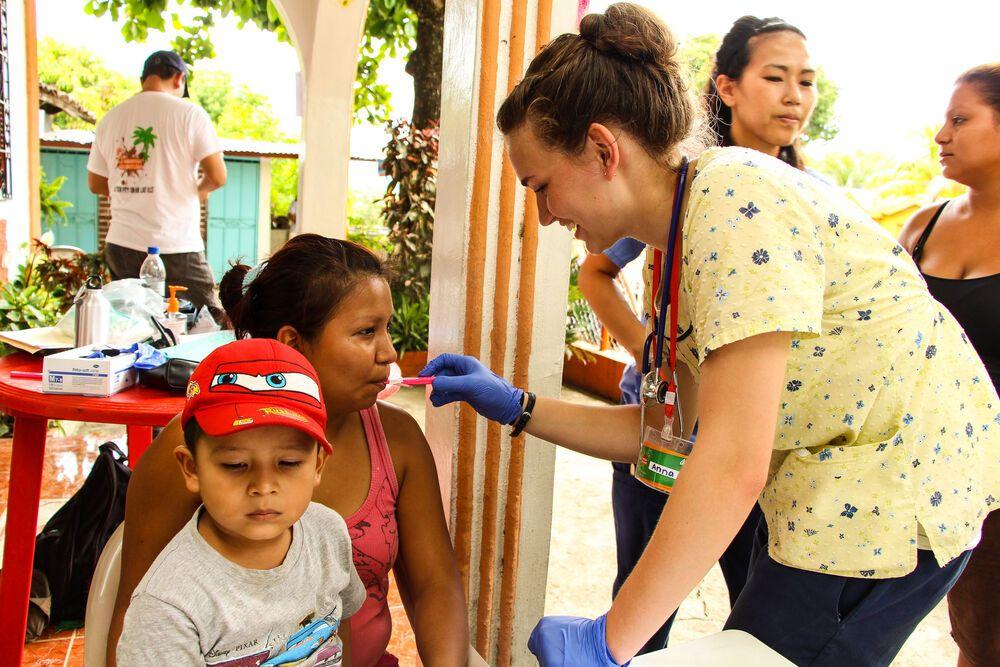 El Salvador: A nurse in the Samaritan Adventure Outreach in El Salvador is preparing patients for their medical check-up.  More Info