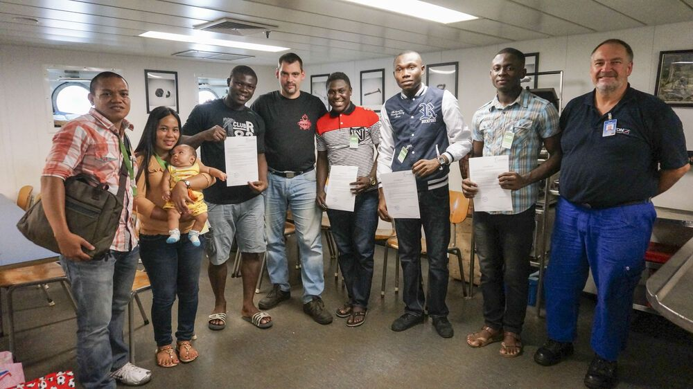 Cebu, Philippines :: First Engineer Stefan Schomas (Germany - center) with Nigerian maritime students he helped provide practical experience for during the visit to Cebu.