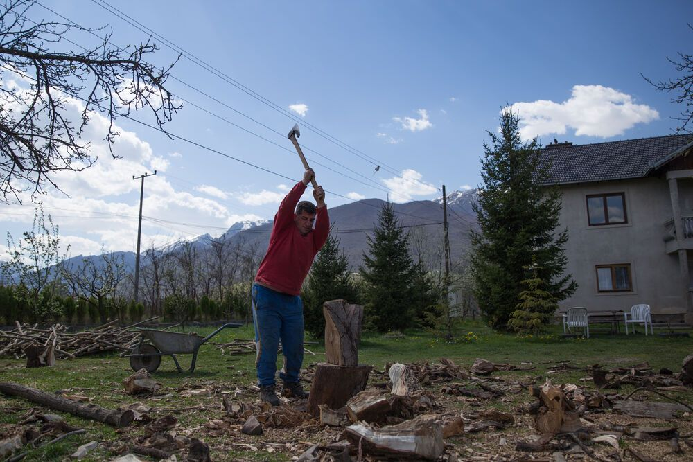 Since most Kosovar homes are heated by wood in the winter, chopping wood is a life survival skill