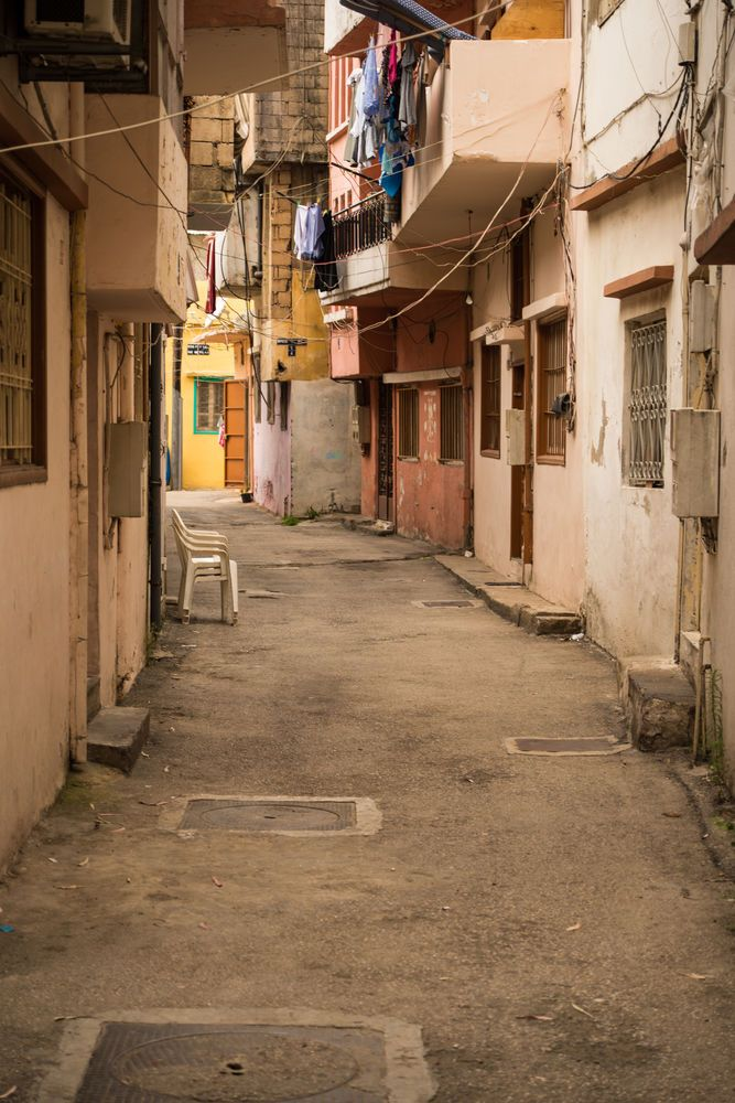 Near East: Narrow alley provides passage between homes in the densely populated urban areas of the Near East.  