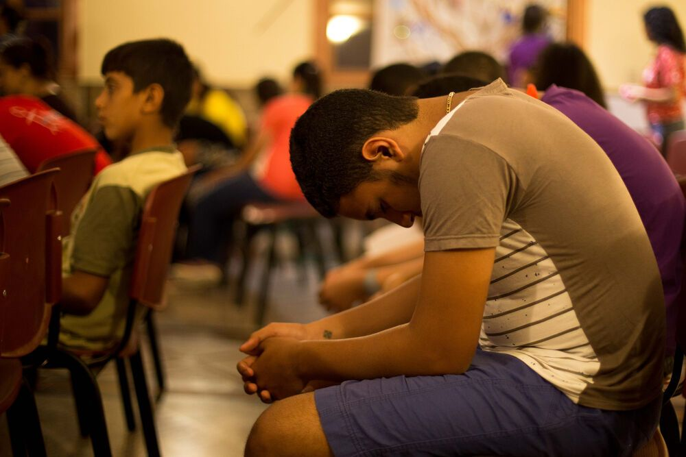 Egypt: During each evening — two hours of prayer and praise— the worship team led a steady stream of songs, Arabic words and melodies flowing from the front of the room at the event for teens in North Africa.   Photo by Josiah Potter More Info