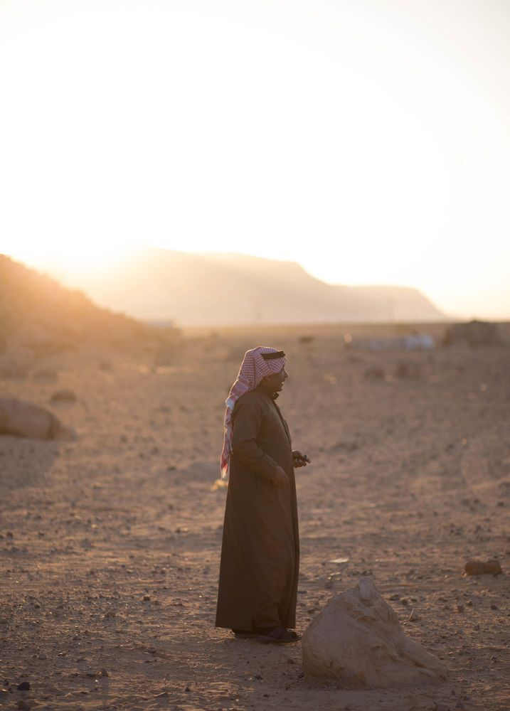 Near East: Bedouin man gazes out into the desert.  