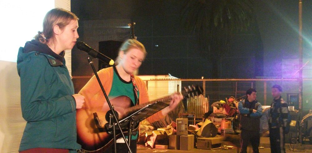 Chile: Marloes and Emma leading worship at the Meal of Love for homeless people in Santiago, Chile.  More Info