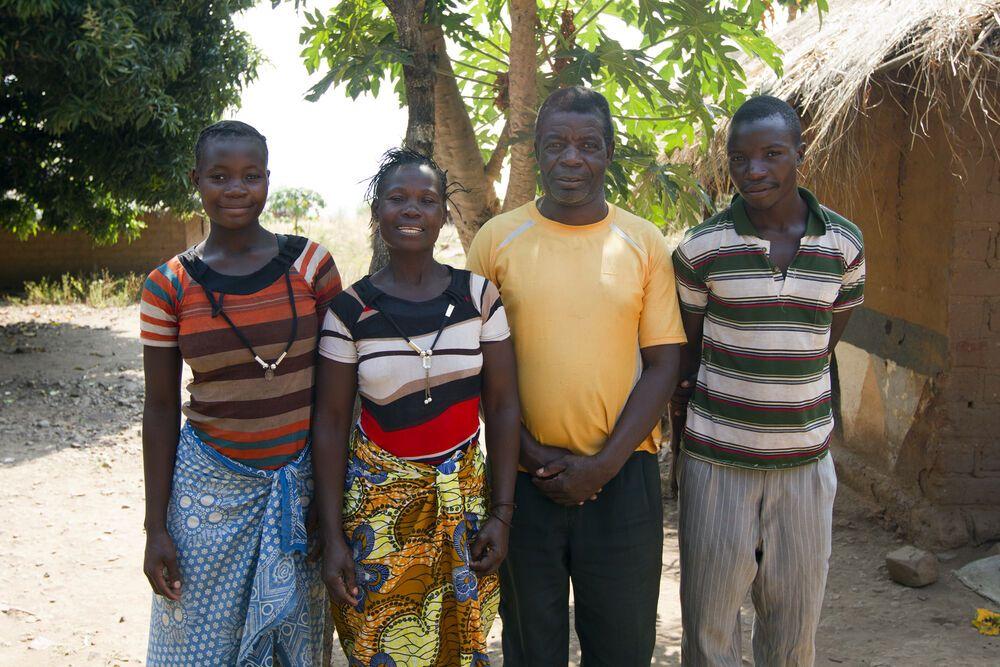 Zambia: Dimas, the headman of Mulima village, with his family. More Info