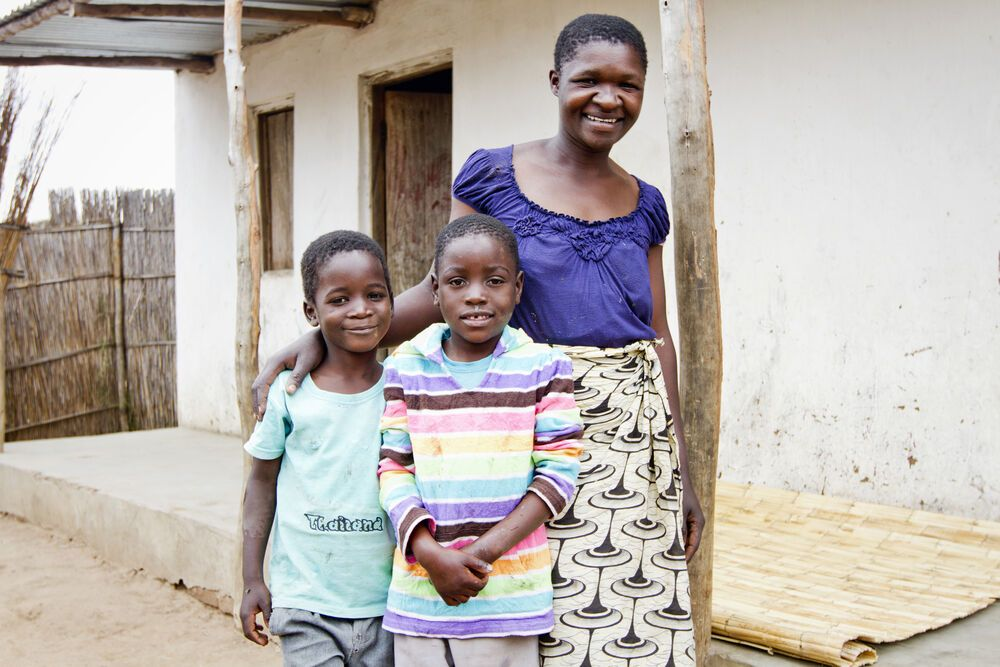 Malawi: Alice, the cook for Chiyembekezo School, with Kasim and Simiton, students she is now looking after.  More Info