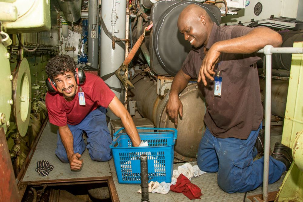 Ships: Yangon, Myanmar ::  Carlos Sabino (Brazil) and Clive Musendami (Zimbabwe) work in the engine department onboard Logos Hope. More Info