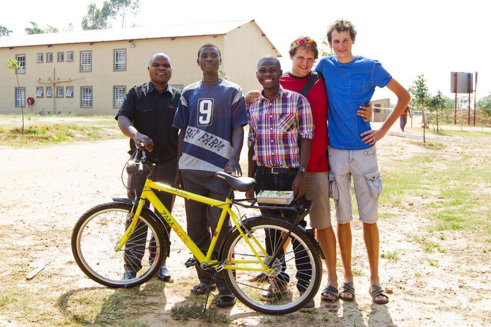 Zambia: OM Zambia Field Leader Isaac Ngambi, (far left), presents Charles Malupande (second from left), a new bike for winning the 10km run More Info