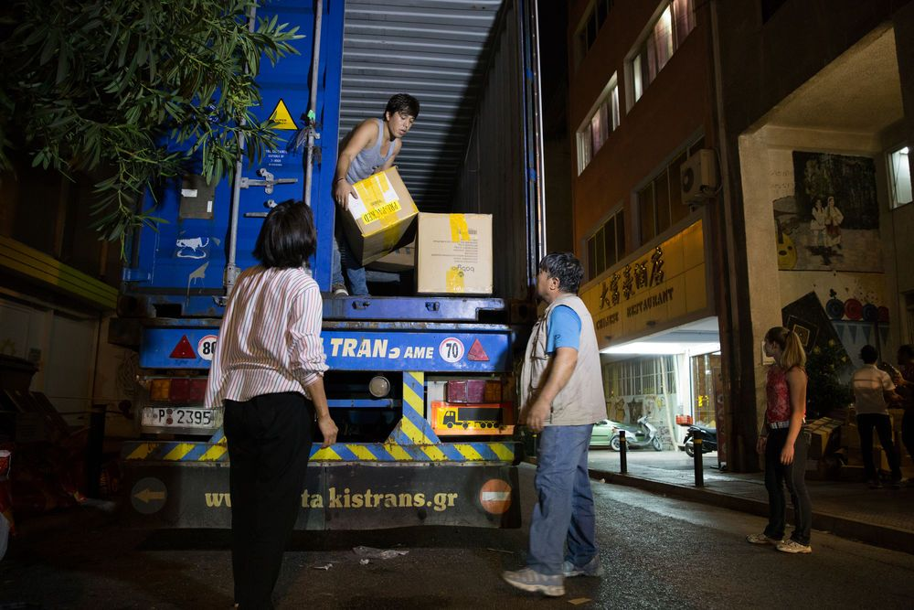 International: Volunteers from Samaria Centre unloading a container of donated items for the refugees.  Photo credit: Kathryn Berry More Info