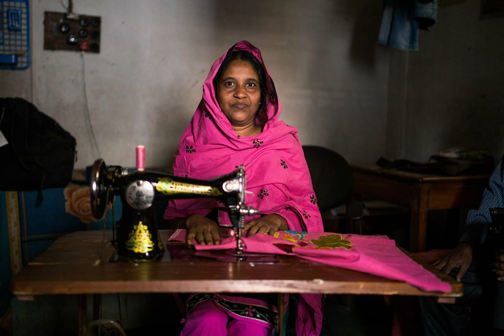 International: One of OM Bangladeshs tailoring programme graduates working for her home-based sewing business, which allows her to provide for her family. More Info