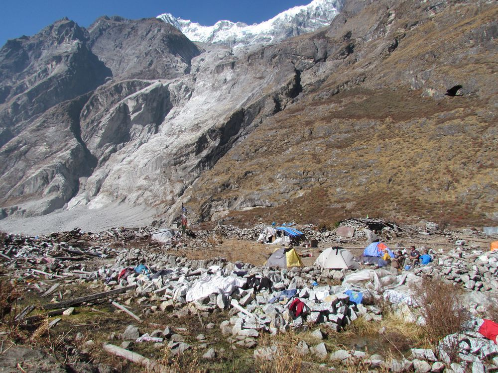 Nepal: An OM Nepal team member set up tents in the destruction of what was once Langtang while they helped to clear debris from several homes and built a semi-permanent shelter to use for future workers. More Info