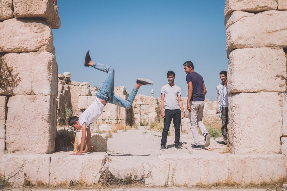 Near East: Arab youth enjoy time with friends among the ancient ruins.  