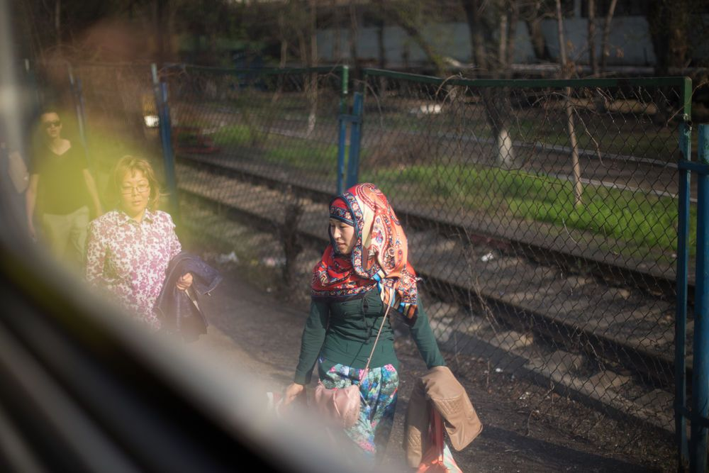 Central Asia: A view of a  Kazkah woman from a train window More Info