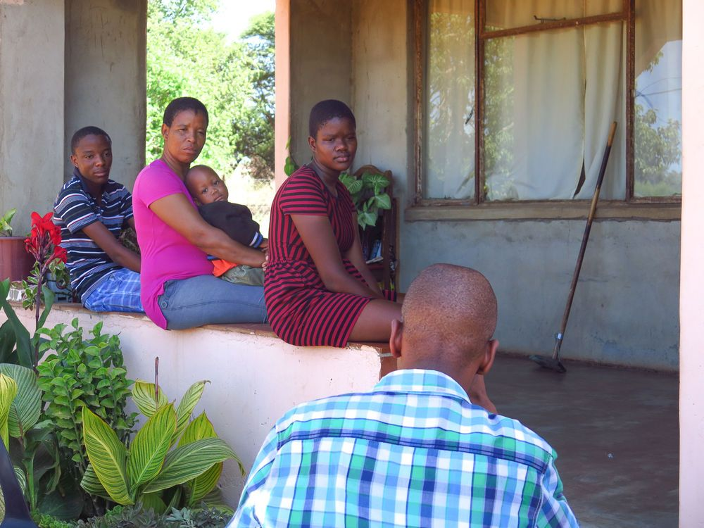 Ships: Kumakwane, Botswana :: Pastor Ntu shares the Gospel with a family at their home. More Info