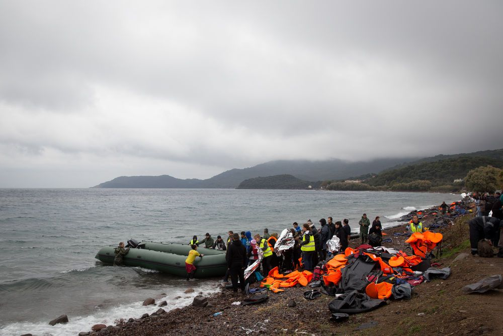 boat full of refugees arriving on Lesvos, Greece