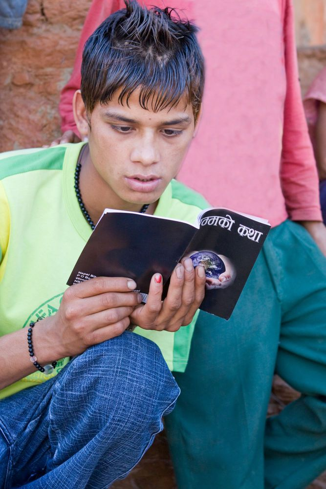 South Asia: A young man intensely studies a gospel book. More Info
