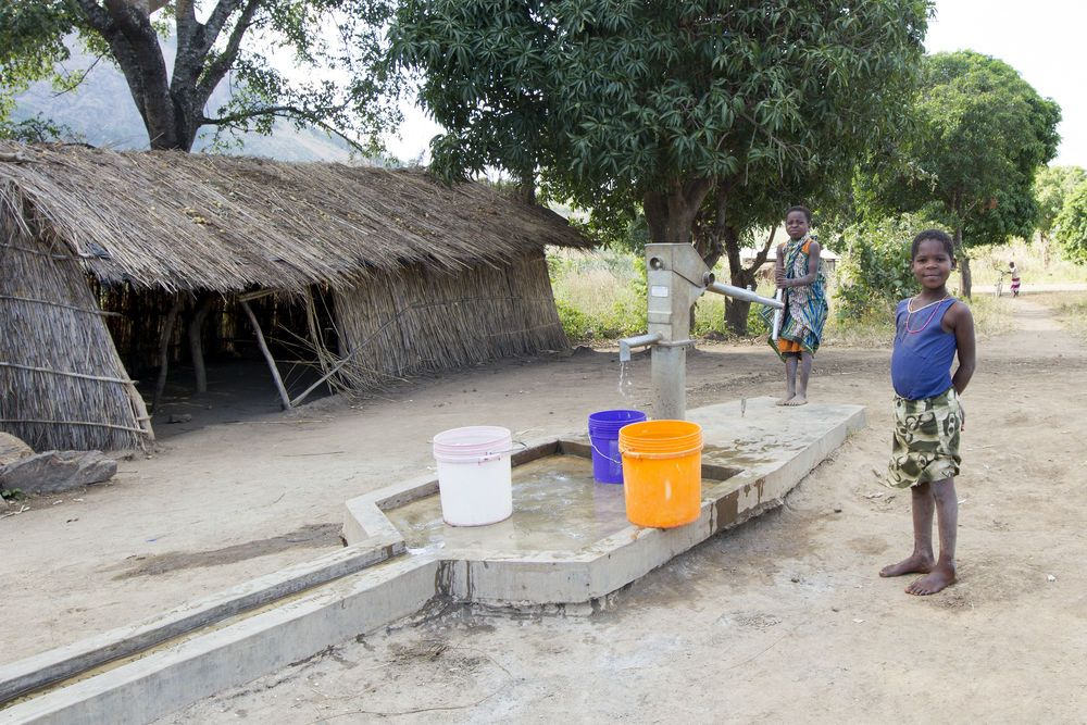 Malawi: Two girls pump water from the OM borehole in Chisopi. More Info