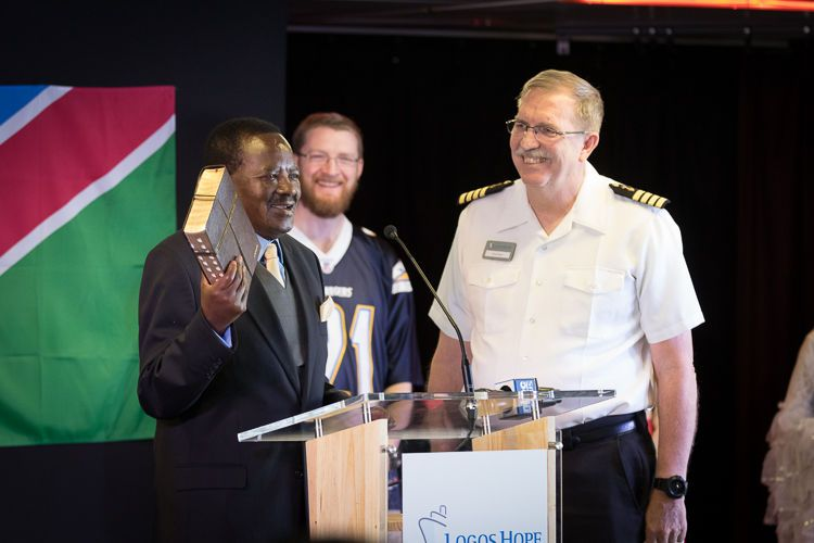 Namibia: Walvis Bay, Namibia :: Namibia's Vice-President, Dr Nickey Iyambo, accepts a Bible from the Captain of Logos Hope, Tom Dyer (USA). More Info