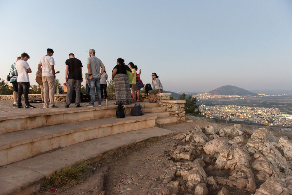Israel: The summer Hope of Israel outreach team worships God on the top of the mountain in Israel. More Info