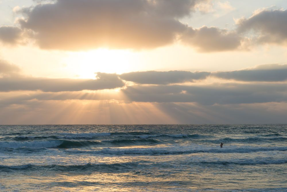 Sun shines through the clouds over the beach in Haifa, Israel. Please pray that God will shine His light in the hearts of the people of Israel.