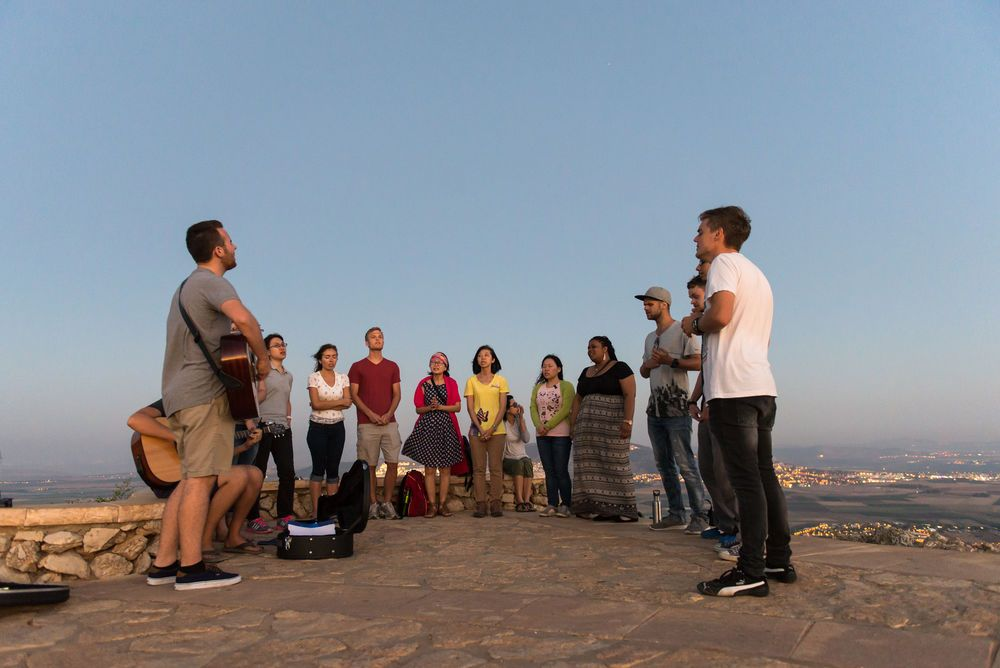 Israel: The Hope of Israel outreach team worships on a cliff. More Info