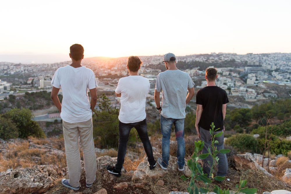 Members of the MENA Travelling Team look out over the city in Israel.
