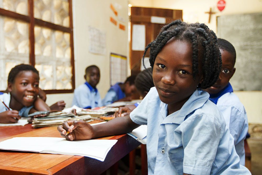 A student looks up from her work at the Good News School II for orphaned and vulnerable children in Mpulungu, Zambia.