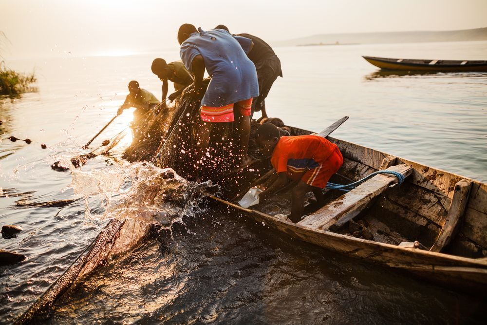 International: Fisherman on the shore of Lake Tanganyika. OM reaches out to some of the most inaccessible villages in the area. More Info