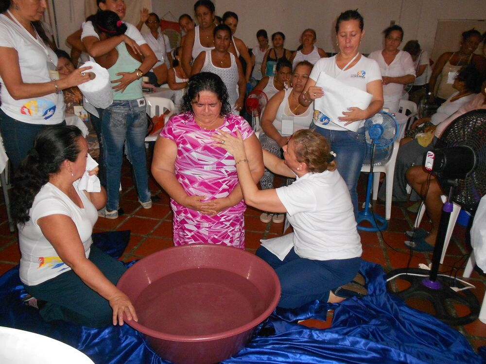 Colombia: A woman is about to be baptised in the Mujeres Eres Libre (Women You Are Free) encounter at the Cartagena de Indias Ladies Prison in Colombia. More Info