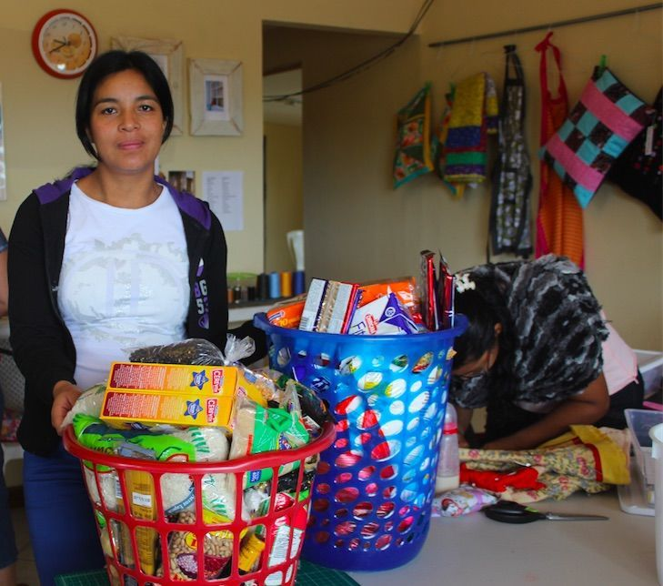 Panama: Women of the Jewel of Hope ministry of OM Panama fill two baskets with food and houshold items to bless a mother in need. More Info